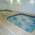 Adults-only indoor roman spas in the exercise room - Tidewater 1802